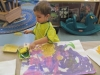 Kayden adding sponge prints to his painting
